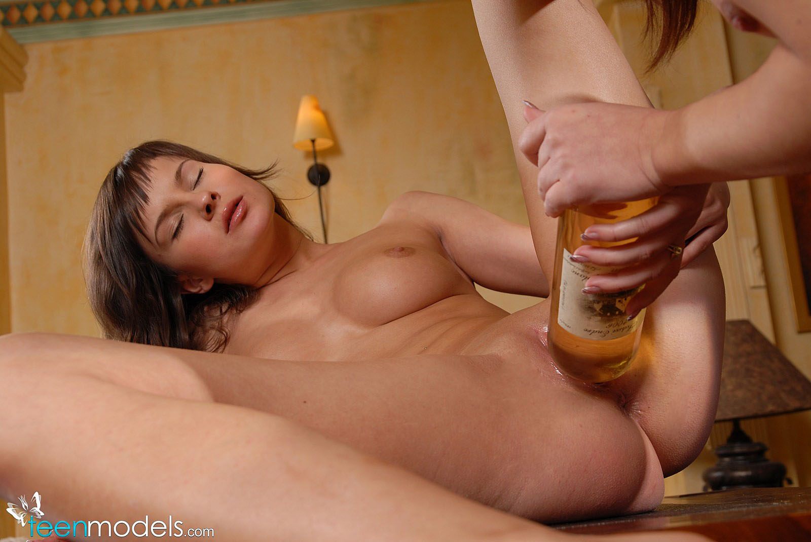 bottle inside young pussy